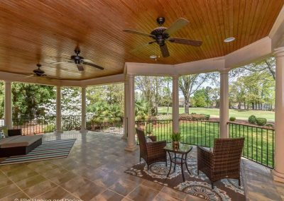 Elite Staging and Design covered outdoor living space with wood ceiling and tile floor