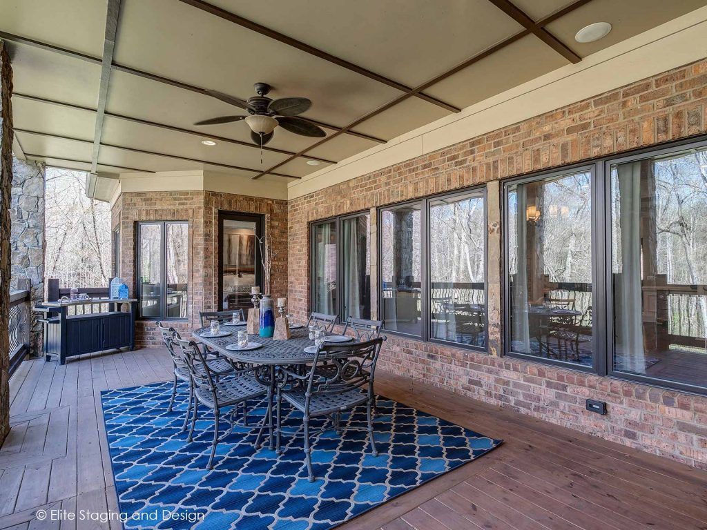 Elite Staging and Design outdoor living space with dining table